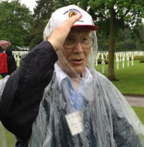 My dad, giving a salute to his fallen comrades at Omaha Beach Cemetery on the anniversary of D-Day